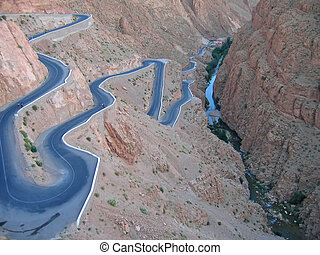 Twisted road going down in a mountain canyon, Gorges Dades...