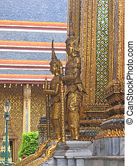 Wat Phra Kaeo and the Grand Palace in gold with warrior...
