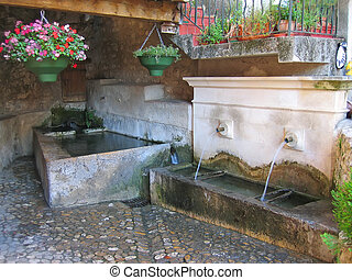 Water fountain in provencal style, Azur coast, South of...