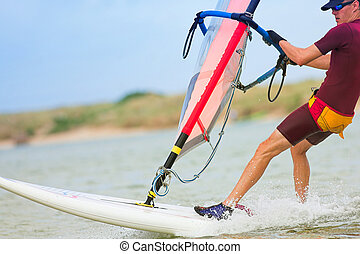 windsurfer #32 - Fast moving windsurfer on the water at...