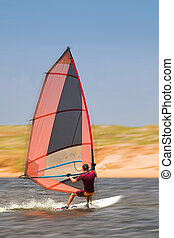Windsurfer 33 - Fast moving windsurfer on the water at...