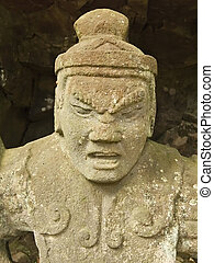 ancient sculpture of warrior deity close-up of ancient...