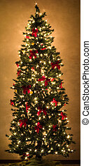 Bright Christmas - a beautiful christmas tree glowing with...