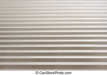 Grooved metal background of stainless steel