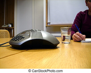 A business meeting - A woman writing in a business meeting