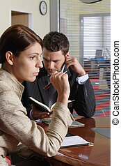 working couple - Business man and woman tsitting at the desk...