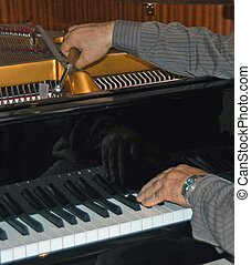 piano tuner tuning piano keys and strings