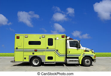 Ambulance - Side view of an ambulance in front of blue sky