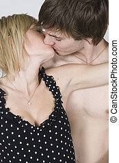 Couple hugging passionately - Young couple hugging...
