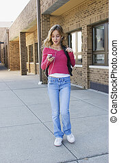 School Girl - Model Release 291 Teenage girl listening to...