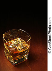 Whisky and Copyspace - Whiskey in light pool on brown table...
