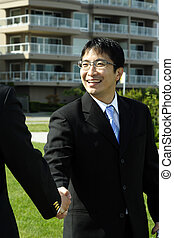 Business handshake - Two businessmen shaking hands on a deal...