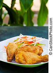 Fried chicken served with grated vegetables Shallow DOF
