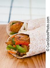 Jerk Chicken Wrap - Caribbean style wrap stuffed with jerk...