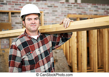 Construction Laborer - A construction day laborer carrying...