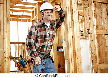 Construction Worker on Site - A construction worker with his...