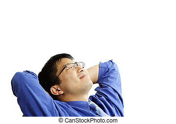Relaxing businessman - A businessman relaxing comfortably at...