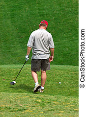 Golfer on the green at the golf course.