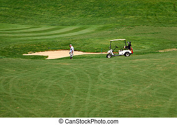 Sand Trap - A golfer heads down the hill to find his golf...