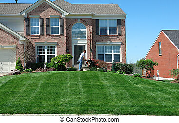 Mowing The Lawn - Professional lawn care company personnel...