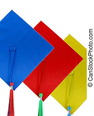 Graduates Caps - Three different colored graduates caps...