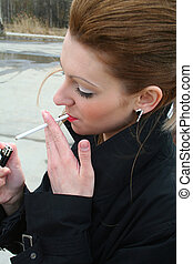 woman with cigarette-lighter - woman gets lighted cigarette