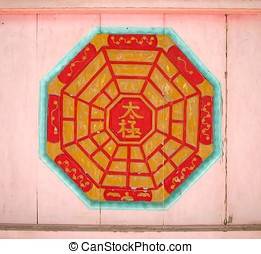 Chinese Taoist Symbol - -- on the wall of an old Chinese...