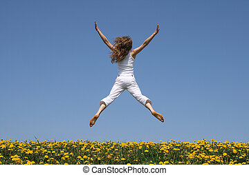 Girl in a funny jump - Girl in summer white clothes flying...
