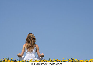 Inner peace. Longhaired young woman in white clothes sitting...