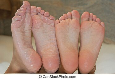 wet feet - two sets of young girls wet feet