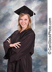 Cap and gown graduate - Blonde young woman wearing a cap and...