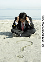 Businessman - A stressed businessman sitting on the beach...