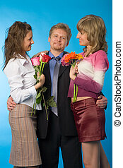 trio - the man and two women on blue background