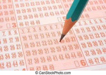 lottery ticket and pencil - close-up of lottery ticket and...