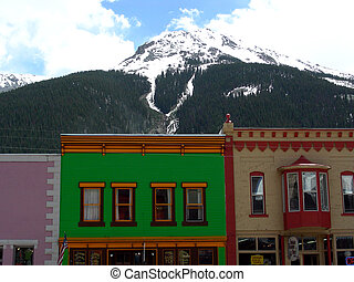 Old West hotel and bordello construction with Rocky Mountain...