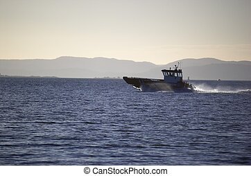 Coastguard - An Oslo fjord coatsguard boat, speeding in a...
