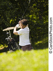 golf club - Golf club: golfer concentrating on the...