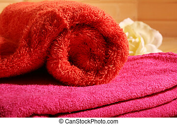 sauna III - red and pink towel on wooden background