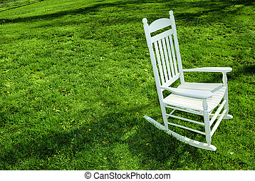 Rocking Chair on the Lawn - White rocking chair on the lawn.