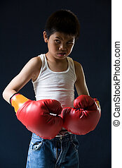 Fighting stance - Young asian boy with mean expression...