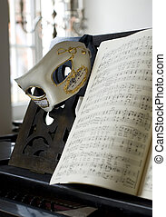 music - Grand Piano, lyrics book and venice mask, focus on...