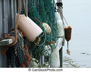 buoys hanging on fish shack