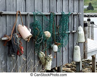 buoys hanging on fish shack - buoys and fish net hanging on...