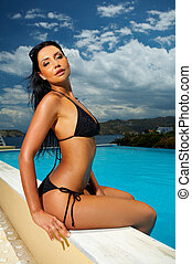 Black Bikini Girl - Beautiful young Sexy woman sitting in...