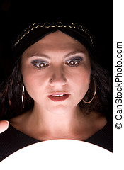 Shocked fortuneteller - Woman looking into her crystal ball...
