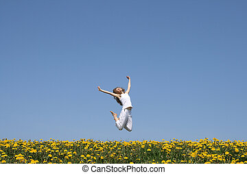Happy jump - Beautiful smiling young woman in a happy jump