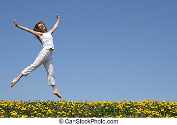 Pretty girl dancing in flowering meadow - Smiling pretty...