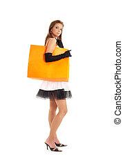 elegant lady with orange shopping bag over white