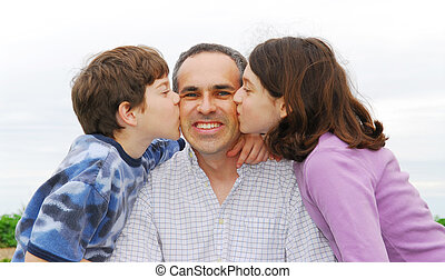 Happy family - Grateful children giving their father a kiss