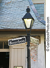 Bourbon Street sign with the haunted Lafitte\\\'s Blacksmith...